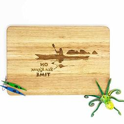 Kayaker cutting board.Paddlers present. Kayak, canoe and pad